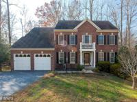 STUNNING Brick Colonial on Culdesac. Large family room
