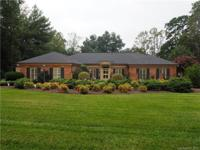 Southern charm can be found in this 4BR, 4BA home on