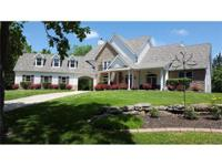 Stunning 1.5 story custom home sits on 30 acres of