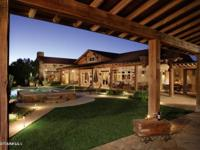 Spectacular custom crafted home on 19.99 acres with the