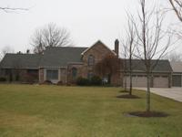 Exceptional 2 story home on 5 flat acres with a 40' x