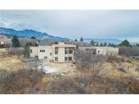 Perched on a nearly 1 acre private mountain setting yet