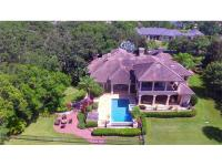 Exquisite four bedroom/six bath LAKEFRONT pool home