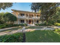 This Old Florida-style estate home resides on one of