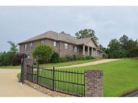 OUTSTANDING CUSTOM ALL BRICK HOME ON 2 ACRES. 7724 SF,
