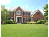 Look no further - this stunning, all brick estate home
