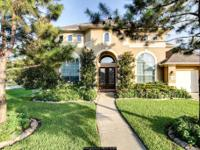 Mediterranean home on a corner lot in the lovely gated