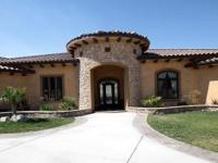 Gorgeous Tuscan style custom single story on 5 acre