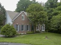GORGEOUS BRICK FRONT COLONIAL WITH STUNNING UPGRADES.