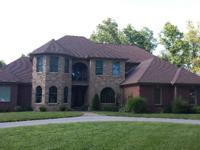 Executive level home with private drive in a beautiful