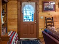 PICTURESQUE WITH LOG HOME SITTING ON 64.46 ACRES!! IT