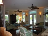 This exquisite home ''ISLAND BLUE'' in gated Destin