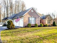 ONE OF A KIND BRICK FRONT HOME W/ EXTENSIVE
