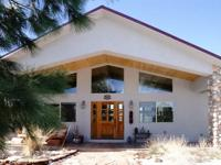 A super, lovely stucco, 1 level home in the country.