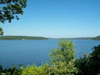 Tremendous edge of bluff lake view. Four bedroom, four