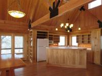 BEAUTIFUL LOG HOME on 40 ACRES with 30x44 SHOP!! This
