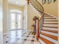 Gorgeous custom home w/ beautiful 25' ceilings & top