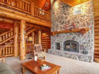 Gorgeous Custom Log Home nestled on 32+ acres. Designed