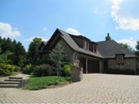 Located in a gated lakeside community, this stunning 4