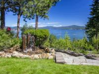 Incredible lakeviews from this Craftsman style home.