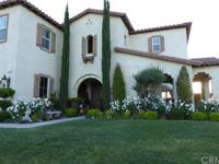 This Mediterranean 2 story home on premium corner lot,