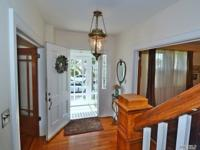 Center hall Brick Colonial/Four bedrooms/3.5 baths;