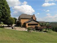 Fantastic setting w/this custom built home on 13 lush