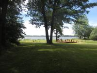 122 Feet of clear frontage. Spacious lake home.