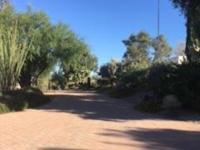 Very attractive western ranch home on 1+ acre corner