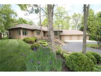 Located on a secluded 2.91 wooded waterfront lot with