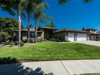 This beautiful single level home is located at the end