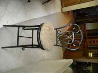 4 Cast Iron barstools with beige cloth seat, moving