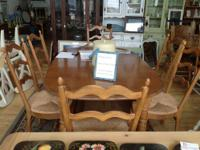 A dining table with 4 chairs. chairs: metal base with