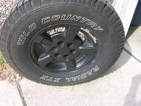 Here I have 4 rims and tires that came off a 2005 Chevy