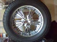 4 chrome rims with 4 tires. never driven in snow. well