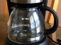 * 4 Cup coffee maker, no problems, can be programmed to