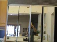 This is a set of 4 wall mounted beveled mirrors. Each