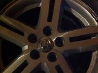 I am selling four avenger SXT wheels off a 2008