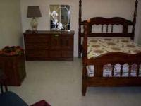Selling is a 4 drawer dresser that also has 2 doors