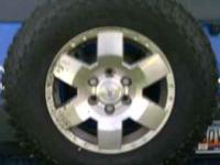 Four Firestone Destination MT tires on Toyota 17 inch