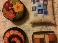 4 really pretty handmade embroidered pin cushions.