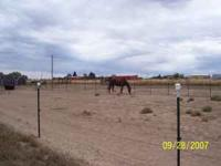 Large horse corral for rent in Watkins. Includes
