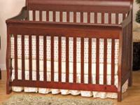 4-in 1 convertible baby crib. Wood. Sleigh Style. Has