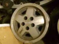 I have 4 aluminum Jeep rims. Descent shape, never