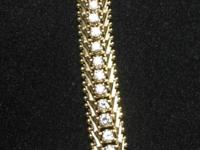 8 in 14k. gold tennis bracelet with 63 diamonds. 2mm