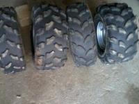 4 fourwheeler wheels and tires that have almost 100%