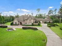 Prestigious home 4.72 acres on the Abita River in Maple