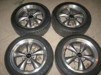 I have 4 Mustang Torque Thrust rims and tires for sale.
