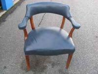 Four blue leather look side chairs in very good