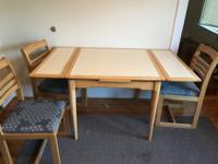 This a sold wood, 4 person (5 piece) dining set. It has